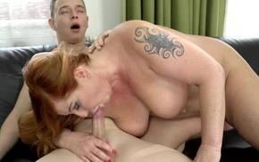 Chubby redhead mature gives an amazing head in excess of cam